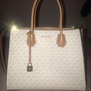 ad325af35209 Women s Michael Kors Vanilla Handbag on Poshmark